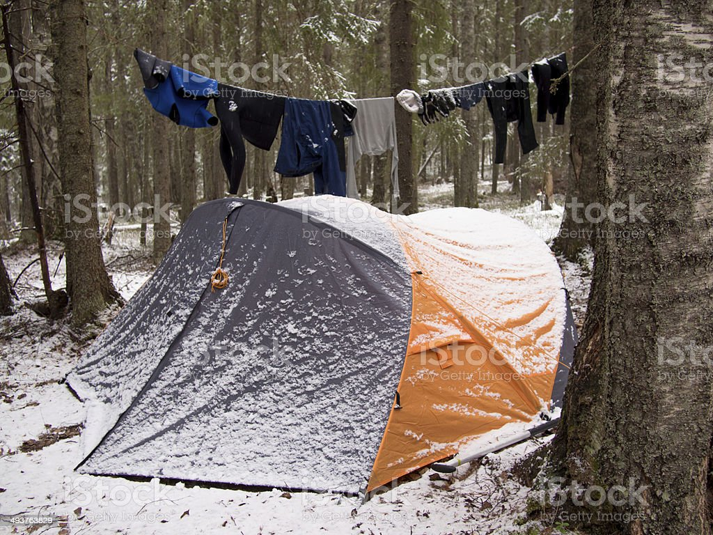 Tent covered with snow standing stock photo
