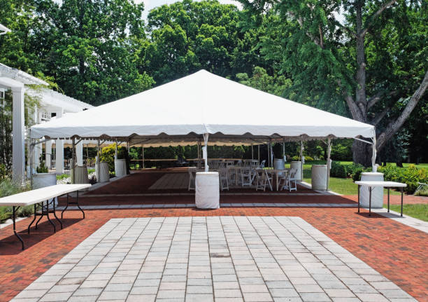 Tent Event Tent Tent event tent. Empty. Nobody. Horizontal. Brick and stone patio in foreground. Horizontal. canopy stock pictures, royalty-free photos & images