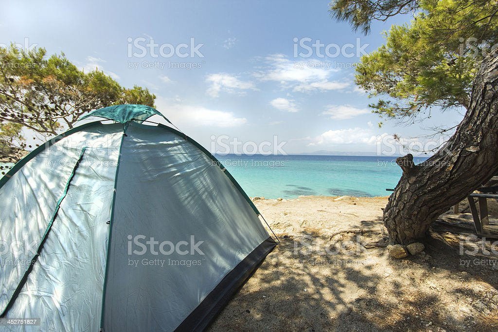 tent for camping on beautiful beach stock photo