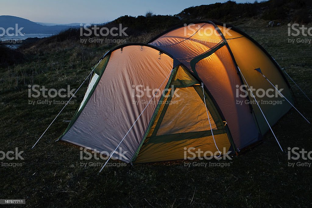 Tent illuminated at night royalty-free stock photo