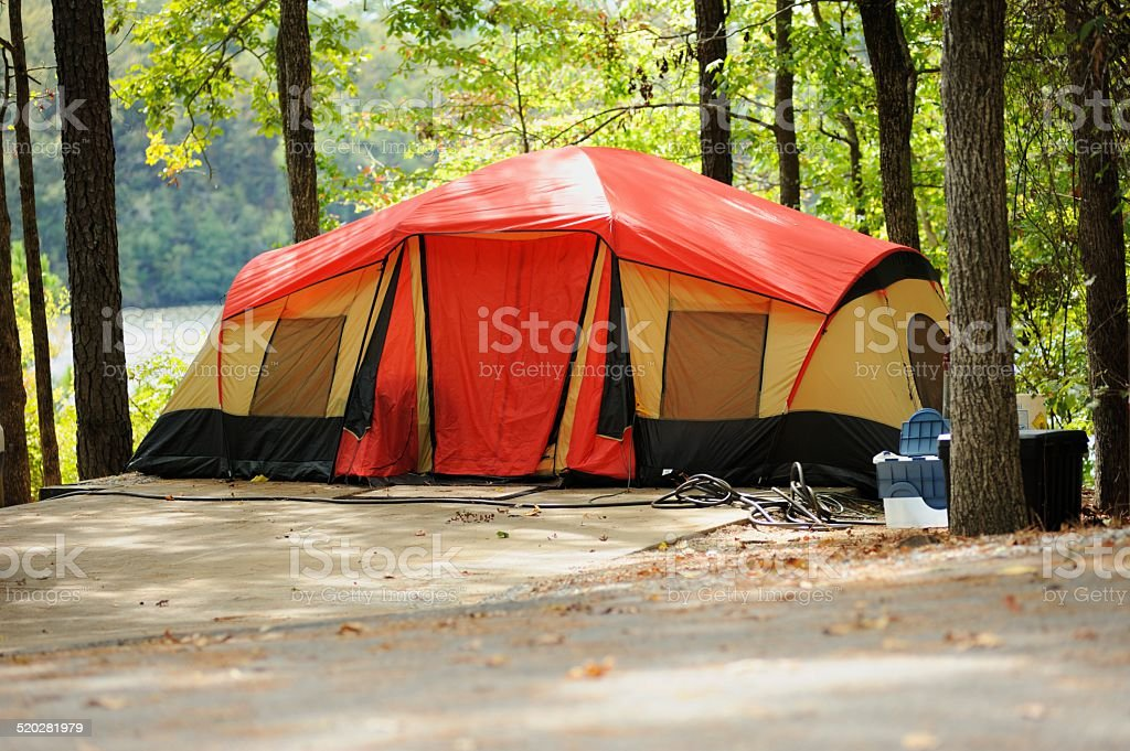 Tent in campsite near river or lake stock photo