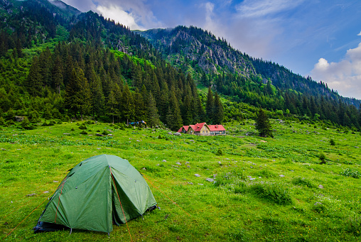 Outdoor peaceful landscape  tourism camp into the mountains.