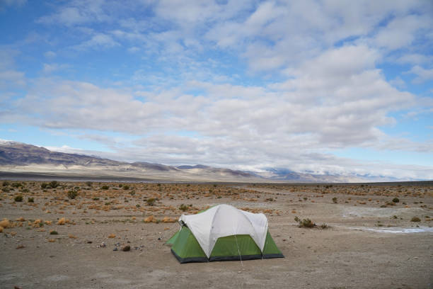 A tent in the middle of a desert landscape. stock photo