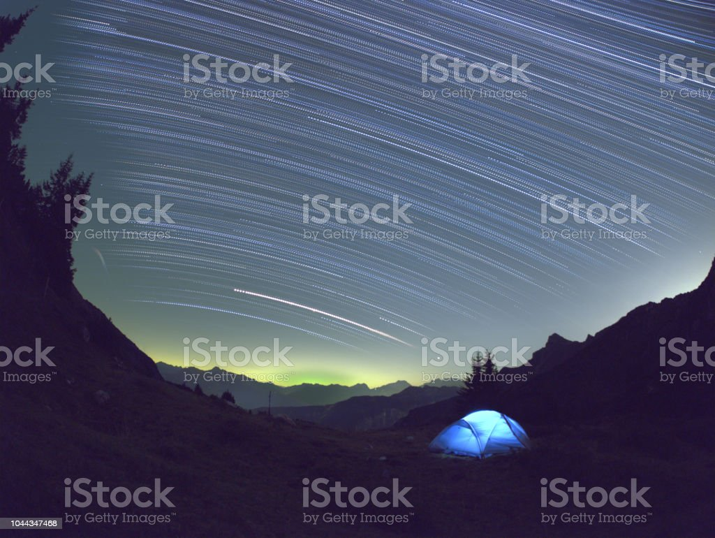 A tent in the mountains under starry night sky at Formarinsee, Austria