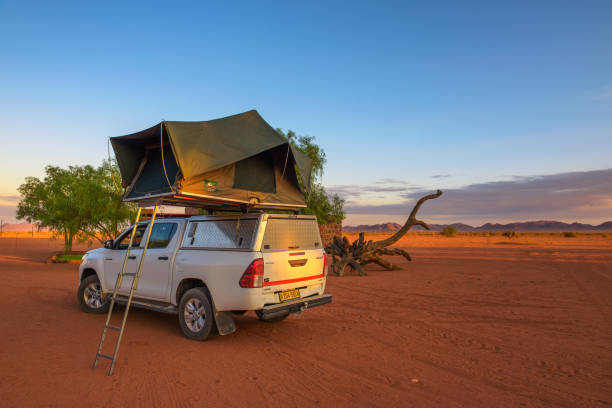 Tent located on the roof of a pickup 4x4 car in a desert camp, Namibia stock photo