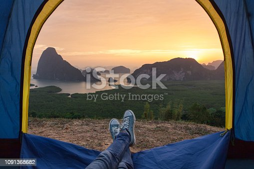 Tent lookout on the sea bay and rocks at sunrise. Holiday of relaxing outdoor camping concept