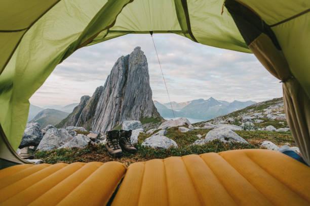 Tent near Segla mountain on Senja stock photo