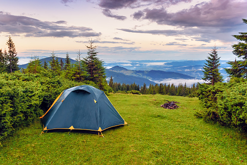 tent on the green grass in the mountains