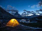 istock Tent on top of mountain near the Matterhorn, night shot 1315352697