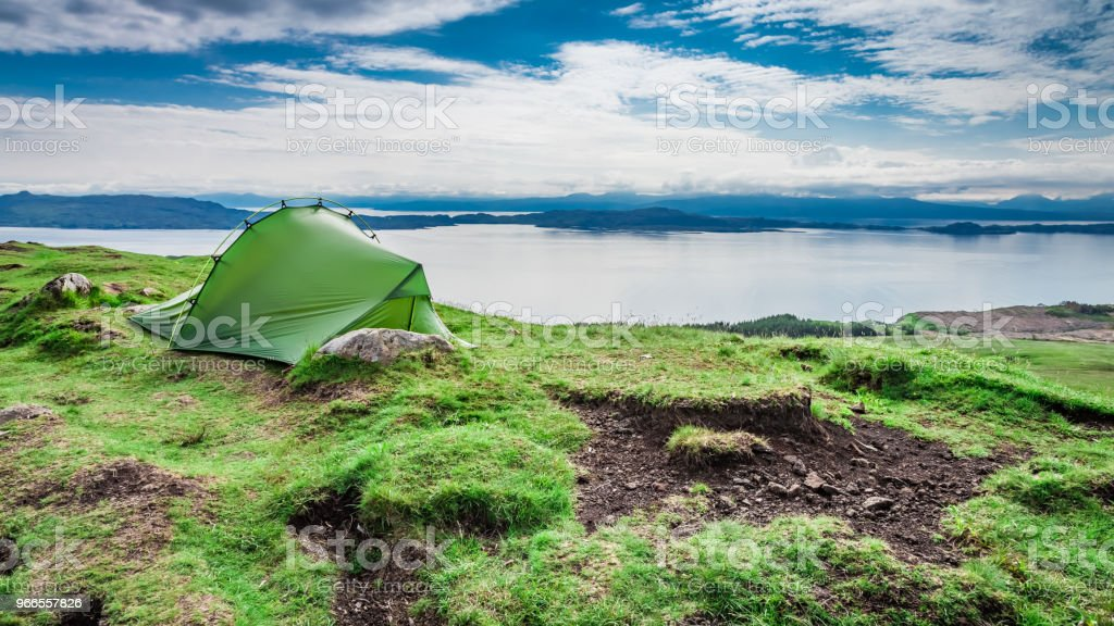 Tent on top of Old Man of Storr, Scotland stock photo