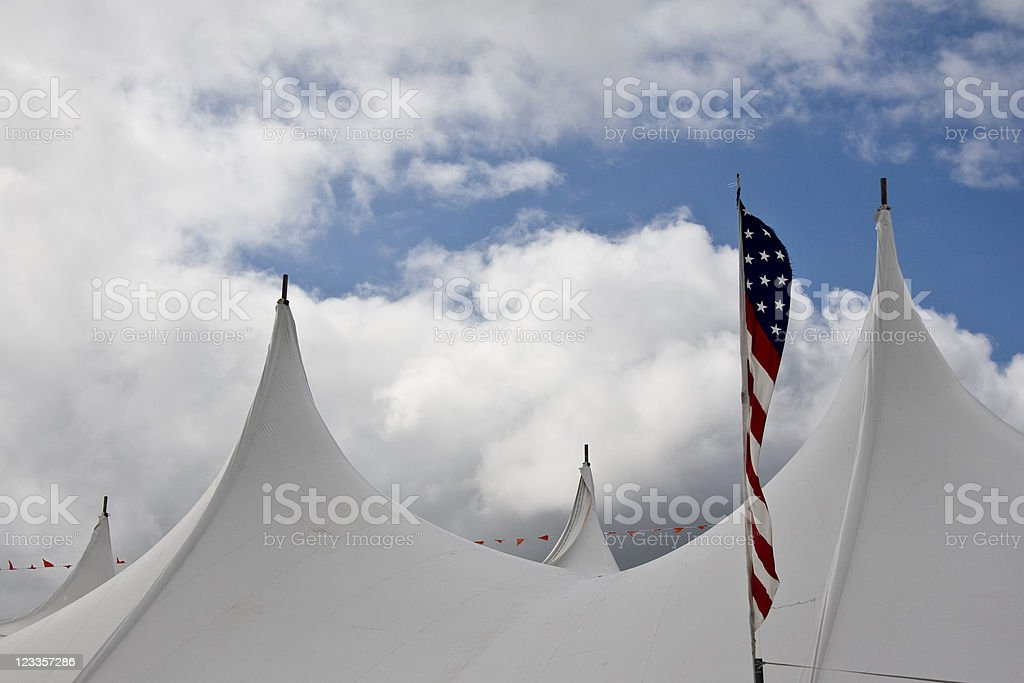 Tent Tops, Clouds and American Flag stock photo
