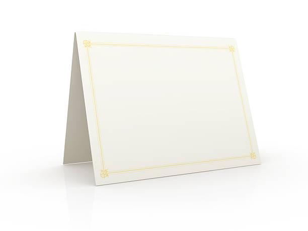 tented blank white card on a white surface - gift tag note stock photos and pictures