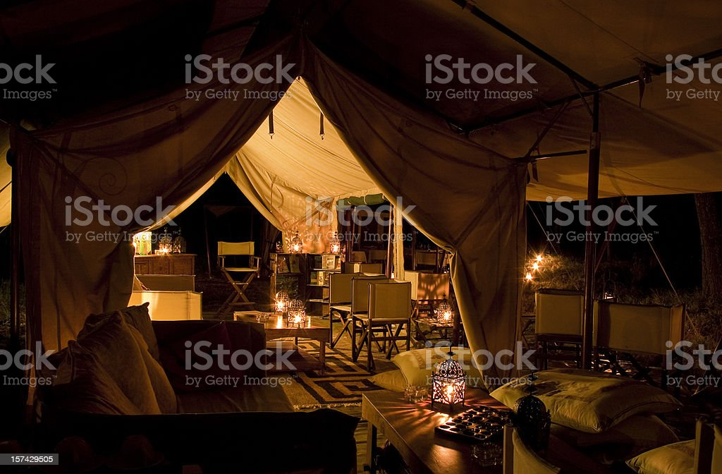 Tented safari camp by night stock photo