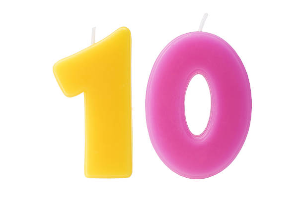 Tenth birthday candle isolated stock photo