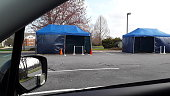 April 1, 2020 Rising Sun, Maryland USA, A view from a car window at 2 tents set up in the parking lot of Stone Run Family Medicine. The tents are for isolating patients that might have symptoms of the Coronavirus and testing.