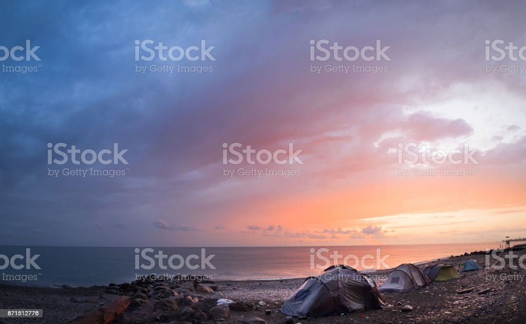 tents in the evening on the shore stock photo