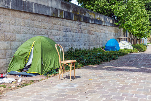 Tents of homeless people at riverside Seine in Paris