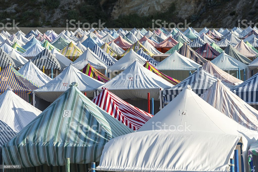 Tents on the beach, Nazarè (Portugal) stock photo