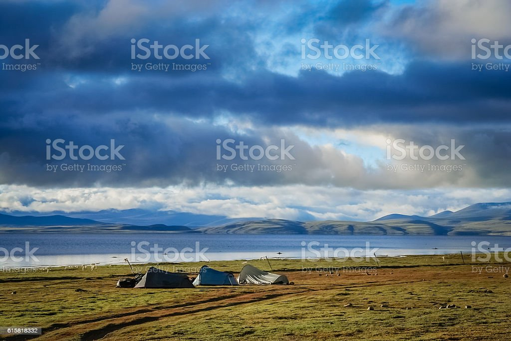 Tents pitched on the shore of Lake Manasarovar stock photo