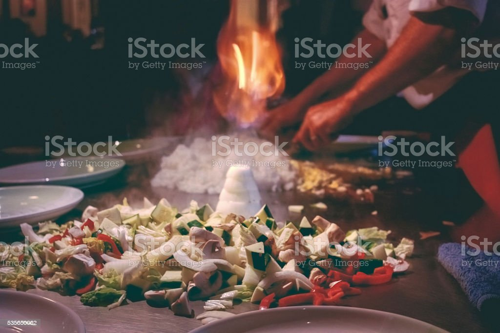 Teppanyaki restaurant. Chef cooking. stock photo