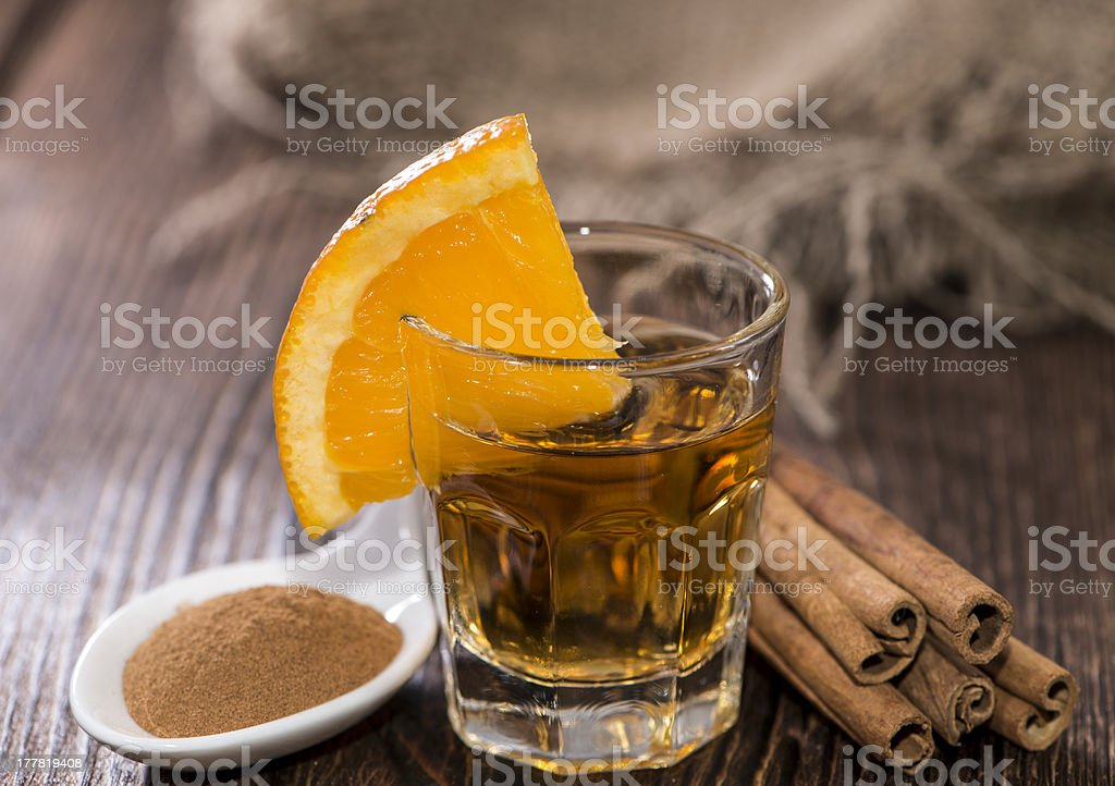 Tequila Gold Tequila Gold with Cinnamon on wooden background Alcohol - Drink Stock Photo