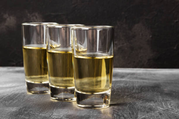 Tequila on a dark background Tequila on a dark background tequila shot stock pictures, royalty-free photos & images