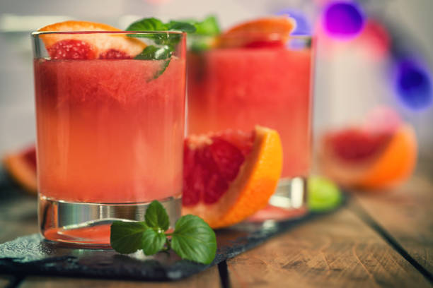 tequila paloma cocktail with fresh grapefruit - grapefruit cocktail stock photos and pictures