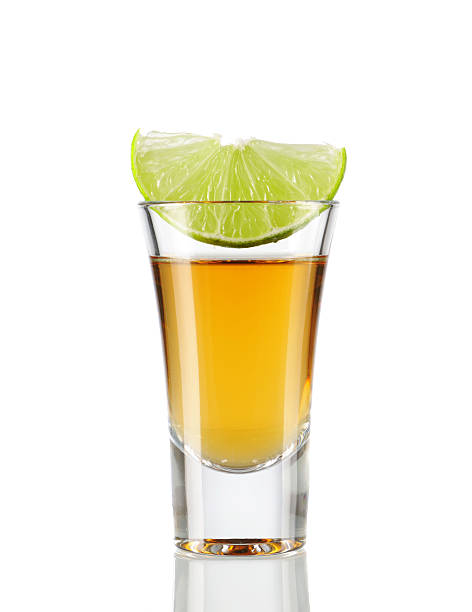 Tequila Tequila  shot with lime isolated on white tequila shot stock pictures, royalty-free photos & images