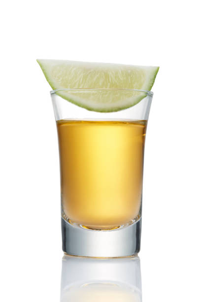 tequila glass of tequila shot isolated on white tequila shot stock pictures, royalty-free photos & images