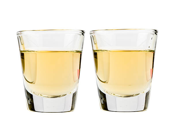 tequila shot Two tequila shots isolated on white background tequila shot stock pictures, royalty-free photos & images