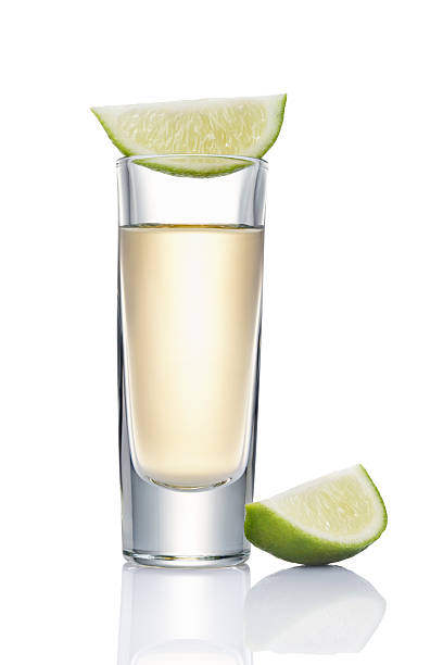 tequila shot glass of tequila shot with slice of lime beside tequila shot stock pictures, royalty-free photos & images