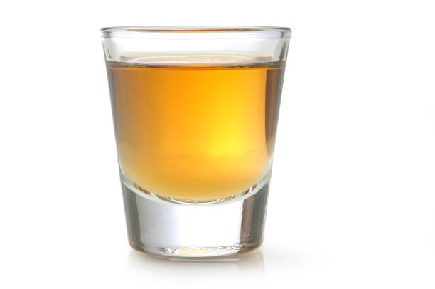 Tequila Shot Glass of Alcohol on White. tequila shot stock pictures, royalty-free photos & images