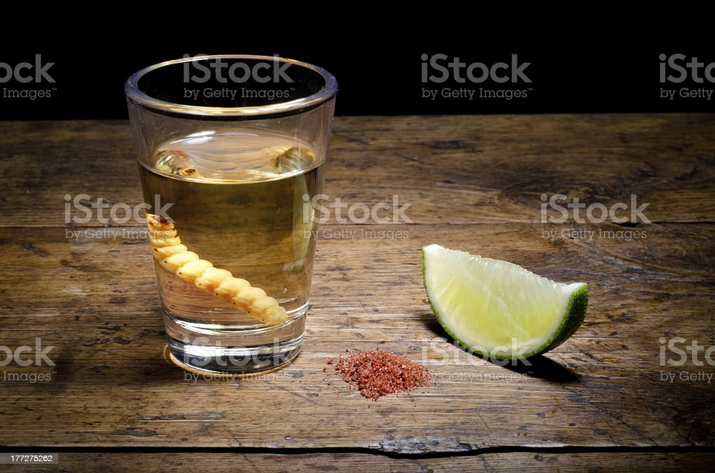 Tequila shot with lime and salt on vintage background. stock photo