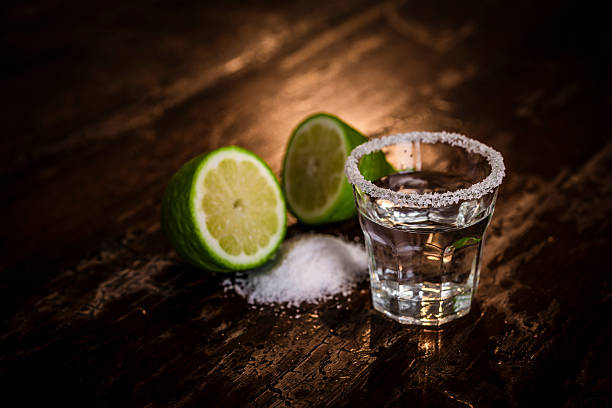 Tequila shot with salt and green lime Tequila shot with salt and green limeTequila shot with salt and green lime tequila shot stock pictures, royalty-free photos & images