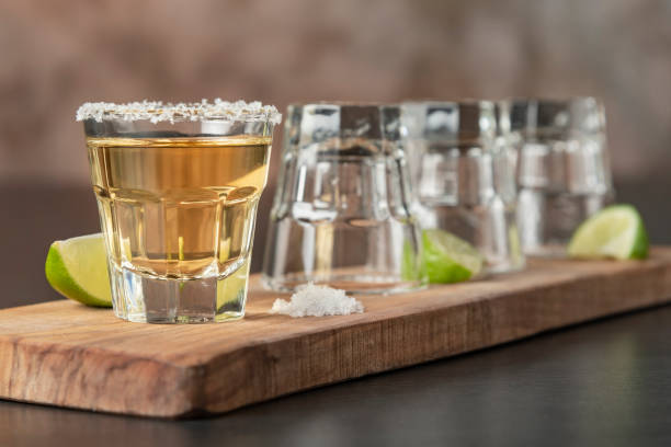 Tequila shots in a row. One more for the road tequila shot stock pictures, royalty-free photos & images
