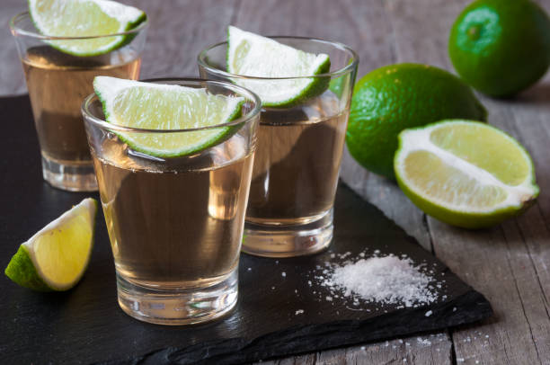 Tequila shots Tequila shots with lime and salt tequila shot stock pictures, royalty-free photos & images
