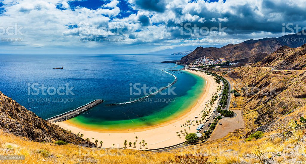 Teresitas beach with sunbeds and mountains on the background stock photo