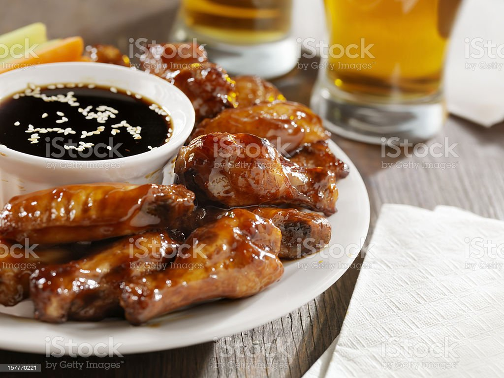 Teriyaki Chicken Wings and Beer royalty-free stock photo