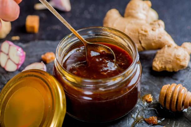 teriyaki sauce in a jar and ingredients from it on a black background stock photo
