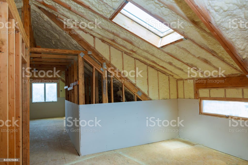 termal insulation installing at the attic stock photo