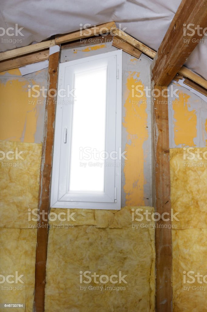 termal insulation installing at the attic wall stock photo