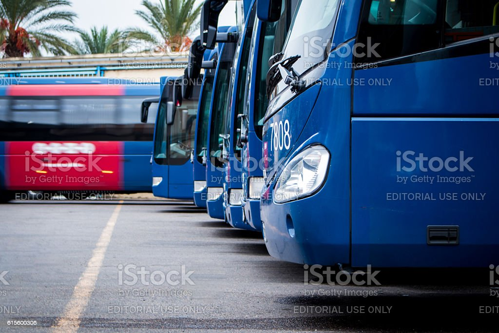 Terminal buses. One leaving for a run stock photo