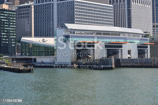 New York, NY - June 30, 2018: Terminal ferry docks ready for an arrival of the Staten Island Ferry in Battery Park Manhattan NYC on a sunny day