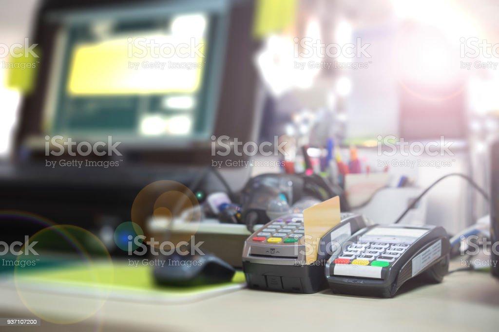 POS Terminal on cashier desk stock photo