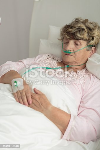 501741686 istock photo Terminally ill senior woman 498919346