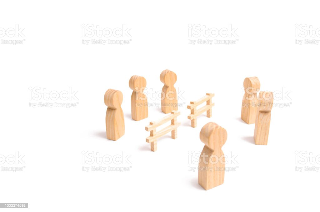 Termination and breakdown of relations, breaking ties. Contract break, conflict of interests. Negotiations of businessmen. A wooden fence divides the two groups discussing the case. stock photo