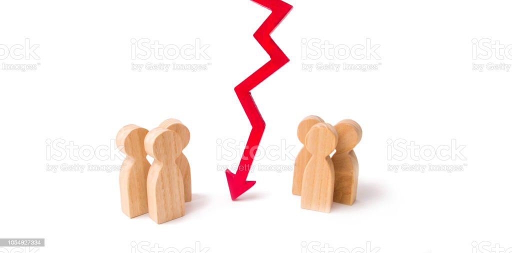 Termination and breakdown of relations, breaking ties. Contract break, conflict of interests. Negotiations of businessmen. A wooden red chart arrow down divides the two groups discussing the case. stock photo