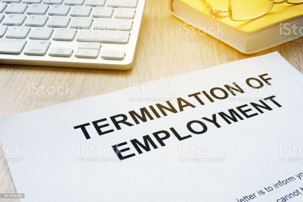 Termination of Employment on an office desk. stock photo
