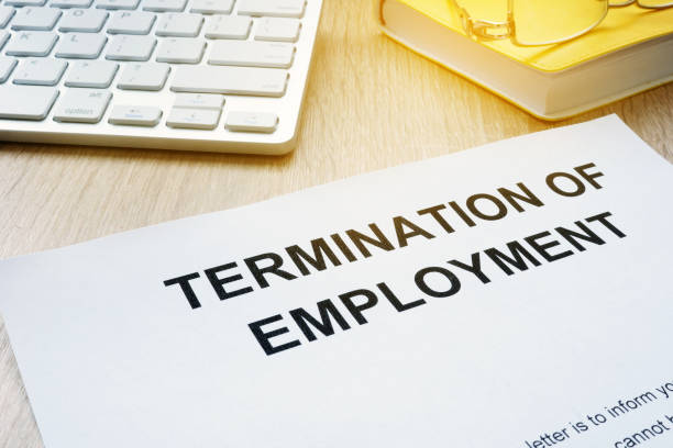 Termination of Employment on an office desk. Termination of Employment on an office desk. downsizing unemployment stock pictures, royalty-free photos & images