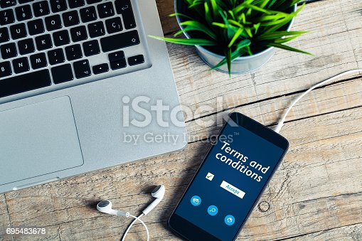istock Terms and conditions on line document in a mobile phone. Business concept. 695483678